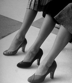 August 1950 // Models displaying different styles of shoes.