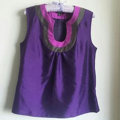 NEW BANANA REPUBLIC PURPLE SILK TOP Beautiful silk like tank top from Banana Republic. BRAND NEW WITHOUT TAGS. Never worn before. It was given as a present but doesn't fit me. Zipper on the side. Perfect for summer. The size is PETITE MEDIUM BUT CAN FIT SMALL AS WELL. Banana Republic Tops Tank Tops