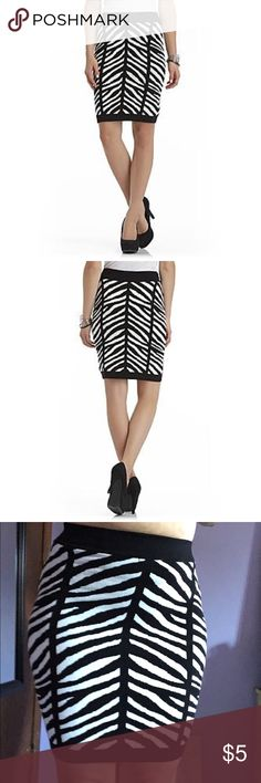 Zebra print sweater skirt! Cute zebra print sweater skirt! I wear a size 9 and this fits me perfectly. Hugs all your curves. Sofia vergara brand. Fashion Nova Skirts Mini