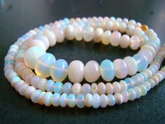 4 inches---3-8mm--- White Ethiopian Opal Smooth Transparent Rondelles. $50.99, via Etsy.