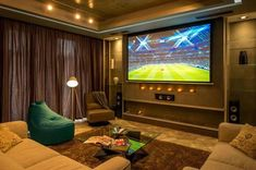 Check Out This Inspiring Footballer's Tenement With Some Dauntless Touch Element From The Owner : Modern Living Room Apartment Design Grey Sofa Glass Coffee Table Brown Fur Rug Blue Light Pouffe Tripod Standing Lamp Floating Lcd Tv And Ceiling Lighting Cinema Room Small, Home Cinema Room, Home Theater Setup, Home Theater Rooms, Home Theater Design, Home Theater Seating, Best Living Room Design, Living Room Designs, Lila Sofa