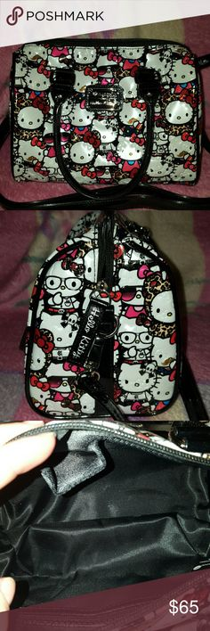 """Hello kitty by Loungefly Patent material Hello Kitty purse has never been used. Quite frankly I'm too old to be sporting around a bag like this, but it is very cute it is very sturdy it does not feel cheap. Can be worn short/long or crossbody. crossbody strap is detectable. Handle drop is 5"""".  Comes with a dustbag. Hello Kitty Bags Shoulder Bags"""