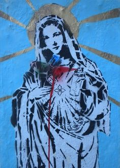 Street art by Free Humanity: http://www.thedirtfloor.com/2010/06/12/virgin-mary-lindsey-lohan-carl-sagan-and-more-street-art-from-los-angeles/