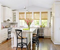 The soft gray subway tiles in this kitchen make a huge impact! Click through for our favorite befores and afters here: http://www.bhg.com/kitchen/remodeling/makeover/before-and-after-kitchens/?socsrc=bhgpin081714graytile&page=19