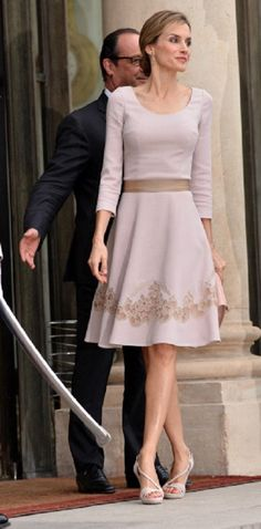 Queen Letizia of Spain looks elegant in an off-white cutaway dress on an official visit to meet French President Francois Hollande, 22.07.2014