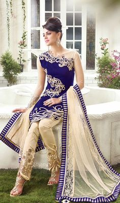 Royal Blue Net and Velvet Embroidered Pant Style Suit Let your charm unfold like the petals of a rose as you step out in this royal blue net and velvet embroidered pant style suit. Beautified with jaal and stones work. #EmbroideredPantStyleSuit #LatestAnarkaliChuridarKameez