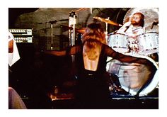 Stevie in black ~ ☆♥❤♥☆ ~ twirling onstage with John McVie to one side of her and Mick Fleetwood behind her