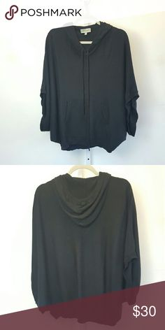 Remain | Black Hooded Sweater Comfortable sweater featuring a loose cape style with a front pocket and hood. Size small but fits up to a large. Open to offers, 20% off all bundles. Remain Tops