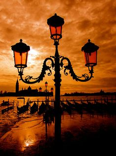 Venice on fire by Scott d'Almeida / Orange and Black Beautiful World, Beautiful Places, Beautiful Pictures, Foto Nature, Street Lamp, Venice Italy, Belle Photo, Italy Travel, Wonders Of The World