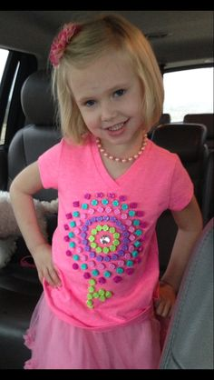 100 th day of school shirt. I let my daughter pick out the beads. I laid it out on shirt the way I wanted hand sewed them on. Problem she lost a bead playing with them so I put a pink rhinestone in the center.