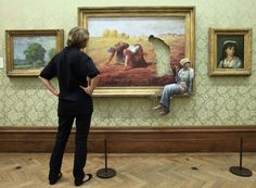 """Banksy at Bristol City Museum / The Gardian: """"Forget about thinking outside of the box. Banksy thinks outside of the frame"""" / Photograph: Matt Cardy/Getty Images"""