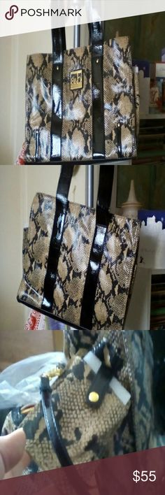 Bag Bag with makeup bag and phone case.  Never used.  Snake pattern,  really chic bag for work, has padded area for your laptop, zipper compartment, pocket on the wall, red nylon interior. 16 in wide, 12 in tall, 2 handles and a shoulder strap, both sides have pockets for water bottle or umbrella or whatever.  The bag doesn't zip at the top.  Thanks for stopping by! Amelia and Blake Accessories Laptop Cases