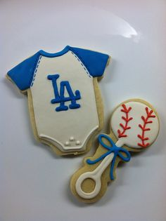 sports onesie and baseball rattle ~ perfect favors for a baseball-themed baby shower!  :)