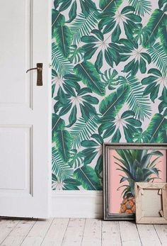 Cool palm print tropical wallpaper is enhanced with this tropical pink pineapple artwork.