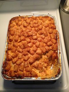Duggar's Tater Tot Casserole     2 lb ground turkey cooked, seasoned, drained 3 2lb bags tater tots  2 cans cream of mushroom 2 cans evaporated milk 2 cans cream of chicken Brown meat & place in large casserole dish. Cover with tater tots. Mix soup & milk together. Pour over top. Bake at 350 for 1 Hour.