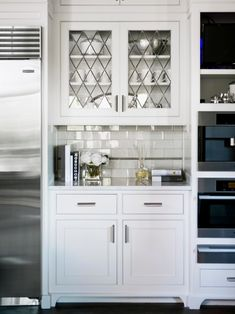 beautiful all white kitchen with shaker cabinets and stainless steel appliances. Kitchen nook with glass cabinet doors Leaded Glass Cabinets, Glass Front Cabinets, Glass Cabinet Doors, Glass Doors, Cabinet Decor, Glass Kitchen Cabinets, Hutch Cabinet, Cabinet Fronts, Cabinet Ideas