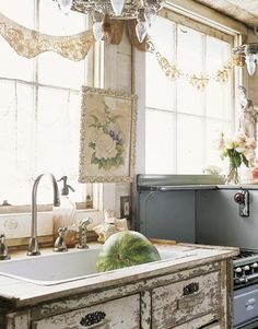 Lace Garland  Instead of full window treatments, string a lace border along kitchen windows. It will let more light into a dark room and add vintage charm.
