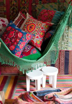 we will sell these amazing embroidered Mexican cushions as well as cool crochet hammocks like this green one. and rugs and bags and ottomans and EVERYTHING BOHO