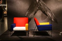 Moooi co-founder Marcel Wanders took inspiration from fellow Dutchman, De Stijl painter Piet Mondrian, to create the Charles Chair. Part of the brand's 2015 collection, the chair's cushions are upholstered in primary colours with a simple, minimal black frame  Wallpaper* Magazine: Salone del Mobile 2015