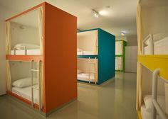 Emanuel Hostel in Split, Croatia, with colourful bunk bed booths and graphics on walls by Lana Vitas Gruić and Toni Radan.