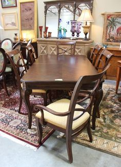 6 Chairs dark Finish 2-20″ leaves Curved legs