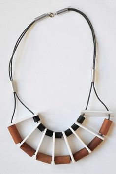 Lauren Manoogian. Cool technique with the flat pieces, I'd prefer the beads between be more feminine to increase contrast