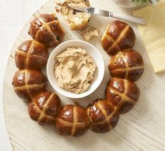 Hot cross bun ring with spiced honey butter. Make these cinnamon-spiced fruit buns into a pretty centrepiece for your Easter table, and serve with a sweet butter(Easter Baking Recipes) Sweet Butter, Honey Butter, Hot Cross Buns, Bbc Good Food Recipes, Bread Recipes, Baking Recipes, Easter Treats, Easter Food, Easter Recipes