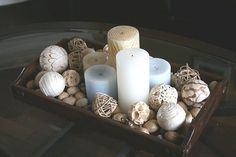 Perfect for a dining table centerpiece, inside or out. Or coffee table in living room Love the casual, impromptu feel of it, and the pale blue candles are a nice touch Dining Room Centerpiece, Decoration Table, Centerpiece Ideas, Centrepieces, Coffee Table Centerpieces, Everyday Table Centerpieces, Dining Table Decor Everyday, Candle Arrangements, Beach Decorations