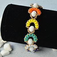 Do you like 2-hole seed bead jewelry? This article will share a colorful 2-hole seed bead flower bracelet with you. Hope you like it.