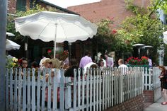 The Boulevard Restaurant and a great example of what a picket fence and some flowers can add to your business or restaurant appearance and curb appeal!