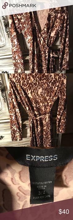 Brown & white animal print dress Express animal print wrap around dress. Express Dresses