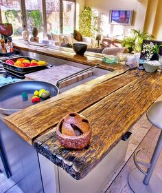 traditional kitchen with reclaimed wooden countertops. Reclaimed Wood Kitchen, Wooden Kitchen, Kitchen Redo, Reclaimed Wood Countertop, Wooden Countertops, Outdoor Kitchen Countertops, Countertop Types, Wood Bar Top, Reno