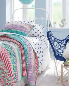 With the vibrant colors of a sweet fairy garden, this pieced quilt and sham cast a spell with eight pretty prints (stripes, stars, and florals) and one solid. Quilted by hand.