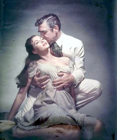 """Clark Gable's thinking, """"I better not put my hands any higher."""" Yvonne de Carlo's thinking, """"I wish he put his hands up higher."""" (from """"Band of Angels"""" 1957)"""