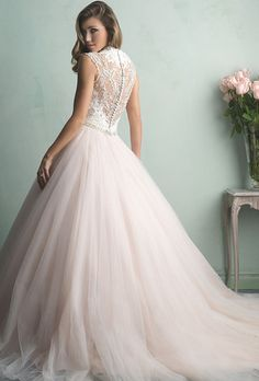 Brides: Allure Bridals. Dress Avaiable at Best Total Wedding PlazaThis is truly the ballgown of a princess - a gauzy tulle skirt topped with an incredibly gorgeous lace bodice and a sheer, beaded back.