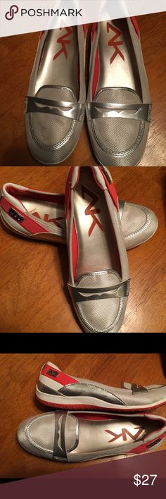 Anne Klein slip on textile shoes in a size 8.5 Very nice Anne Klein ladies slip on shoes in a size 8.5. Done in a silvery white with red accents. Great for walking or everyday wear. Fits true to size. Smoke free home. Thanks for the interest and God Bless Anne Klein Sport Shoes