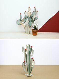 Estos cactus modernos de madera se pueden dejar con su acabado en madera natural o se pueden pintar para crear una más auténtica planta de la casa mirando.