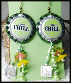 #436--Chill Beerings-$18.00  --Polymer backing, glass pearls, misc beads and acrylic flowers, metal math board.  The Chill caps were in a freebie pkg from B'sue supplies.   by Cherie T. Barnes