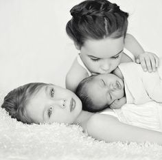 LOVE HER PICTURES & her kids are beautiful too!   Newborn baby boy with sisters,  Black & white, Kisses Jennifer Sharp Photography