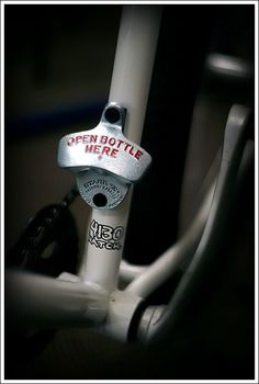 Starr X bottle opener seems to fit nicely to a bike's bottle cage mount