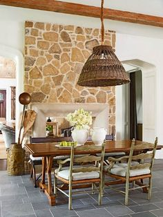 An eye-catching stone fireplace is a popular feature in country French rooms. The natural stone wall brings a touch of the countryside indoors to this cozy hearth room. Country French, French Country Dining Chairs, French Country Kitchens, French Country Living Room, Country Blue, French Style, French Cottage, Vintage Country, Shabby Chic Kitchen