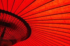 Looking through red bangasa, an oiled rice paper umbrella by Oliver Strewe, lonelyplanet.com #Red_Umbrella #lonelyplanet #Oliver_Strewe #Bangasa