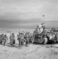 Infantry of the New Zealand Division link up with Matilda tanks of the Tobruk garrison during Operation 'Crusader', Libya, 2 December Nz History, History Online, Matilda, Hms Prince Of Wales, Afrika Corps, North African Campaign, Pearl Harbor Attack, Anzac Day, Army Vehicles