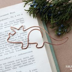 Wire bookmark paperclip dinosaur bookmark copper wirewrapped gift for kid notebook accessories clip-style bookmark party favor Triceratops Wire Bookmarks, Stationary Shop, Wire Jig, Wire Crafts, Wire Work, Bookbinding, Paper Clip, Craft Fairs, Customized Gifts