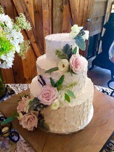 Scalloped rustic buttercream wedding cake