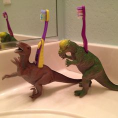 I saw this idea in Family Fun magazine. Just cut holes big enough to fit toothbrushes in those hollow plastic dinosaurs at even work with my little ponies for those with girls!). It's easy and adds a fun touch to the bathroom!
