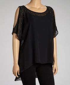 With its long, flowing silhouette and chic shoulder cutouts, this top will set the stage for a stylish ensemble. A trendy hi-low hem adds fashionable finish.