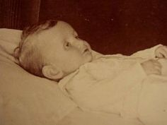 Postmortem Photograph of a baby. So Sad. Victorians' obbession with death was very creepy and interesting. Their way of mourning and rememberence is much different than ours today.