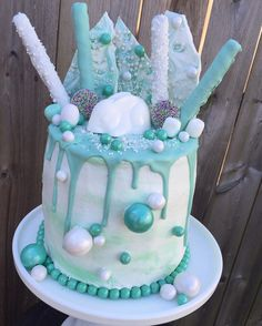 Teal and white Easter Drip Cake featuring a white chocolate Easter bunny!!
