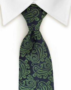 This navy blue and green paisley tie will add sophistication and style to your outfit.